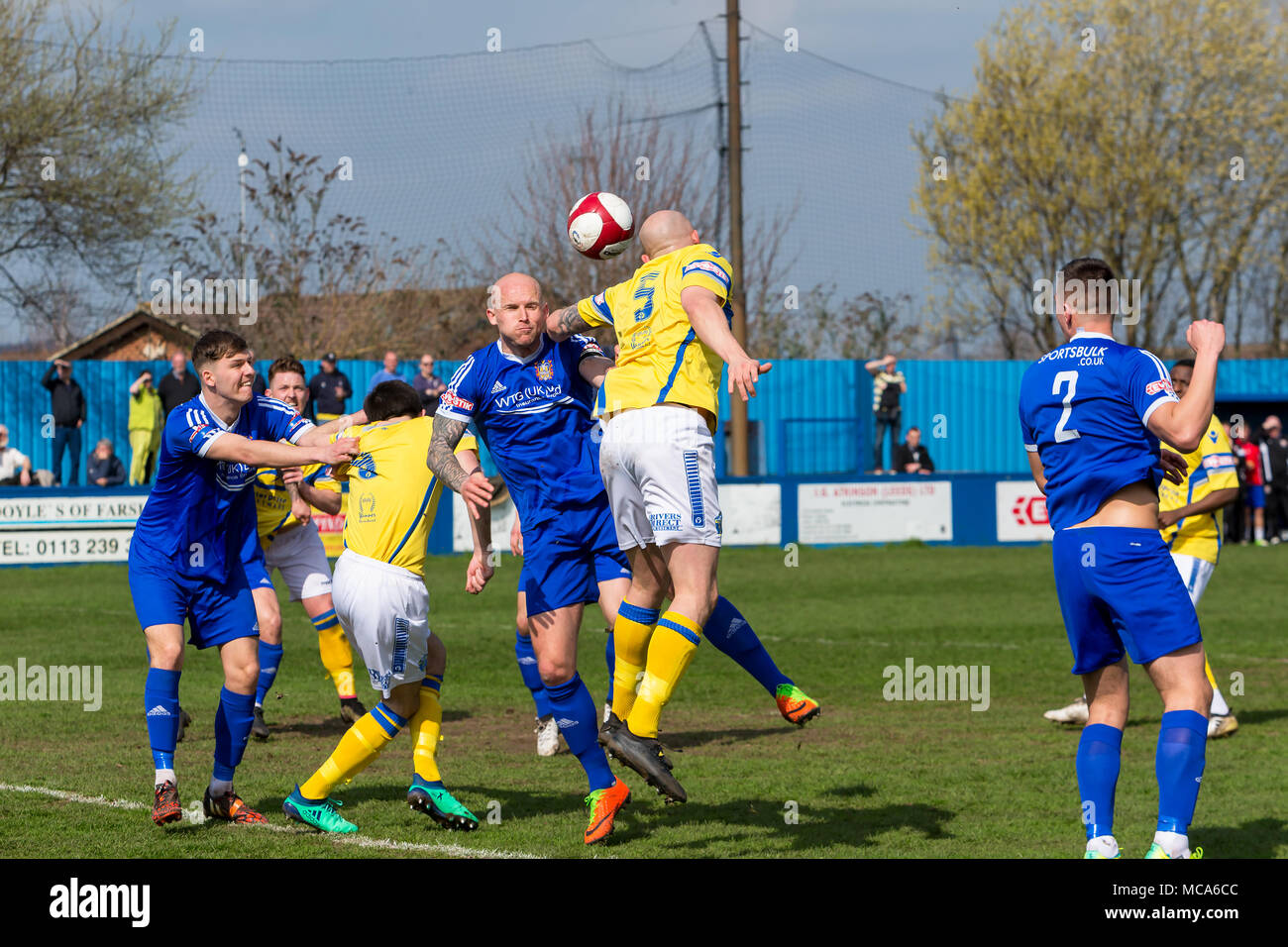 Farsley, UK, 14 April 2018. Warrington Town defender, Jack Higgins, heads the ball into the goalmouth of Farsley Celtic during Warrington's 2-0 win on Saturday 14 April 2018 in the top of the table clash near the end of the season Credit: John Hopkins/Alamy Live News Credit: John Hopkins/Alamy Live News - Stock Image