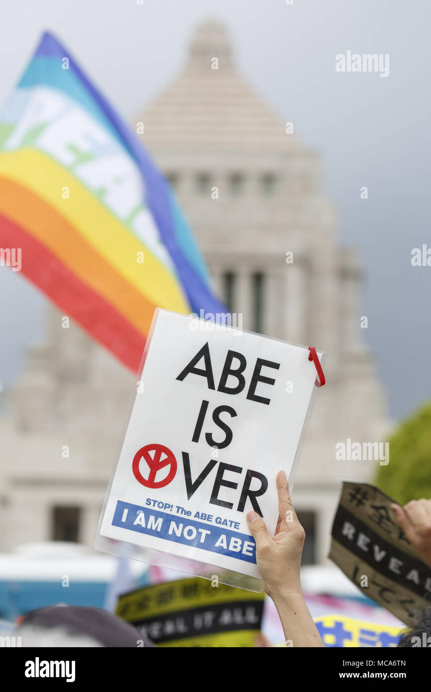 Tokyo, Japan. 14th Apr, 2018. Anti-Abe protesters gather in front the National Diet Building claiming PM Shinzo Abe's resignation. Organizers claim about 30,000 protesters joined the rally demanding Abe's resignation for the Moritomo Gakuen and Kake Gakuen scandals. Credit: Rodrigo Reyes Marin/via ZUMA Wire/ZUMA Wire/Alamy Live News - Stock Image