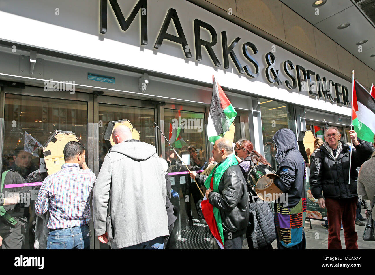 Manchester, UK, 14th April, 2018 Marks and Spencer close the shop doors with protesters inside the store during a protest and picket of what the campaigners say are Israel's British sponsors, shopping district, Manchester,14th April, 2018 (C)Barbara Cook/Alamy Live News - Stock Image