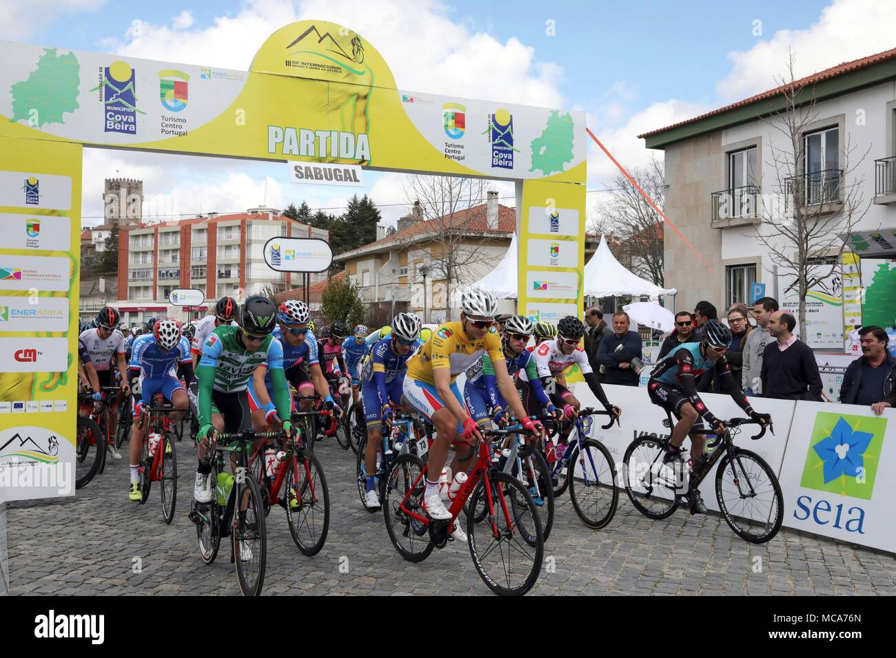 Sabugal, Portugal. 14th Apr, 2018. View of the exit of the second stage from Sabugal, Portugal, on 14 April 2018.César Fonte has been the winner of the second stage of the Beiras e Serra de Estrela Portuguese Grand Prix, which ran between the cities of Sabugal and Seia, next to the Spanish border of Salamanca. Credit: Carlos García/EFE/Alamy Live News - Stock Image
