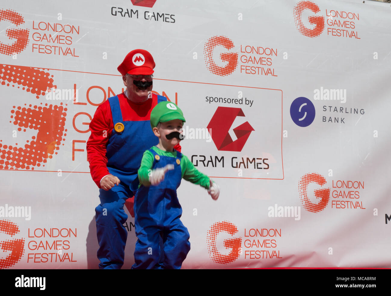 London, Uniteld Kingdom, April 14, 2018: Number of people in games characters costumes on a final day of London Games Festival take to the streets of London in the Games Character Parade. Credit: Michal Busko/Alamy Live News - Stock Image