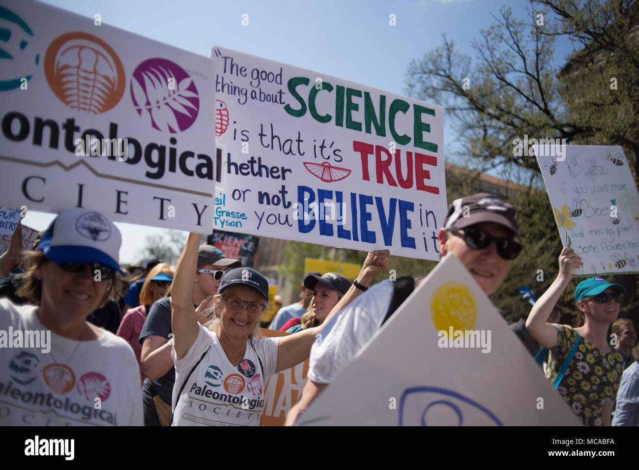 Washington DC, USA 14th April 2018 Protestors walk with signs and banners along Constitution Avenue during the March For Science, a rally sponsored by the nonprofit Nature Conservancy. Credit: Michael Candelori/Alamy Live News Stock Photo