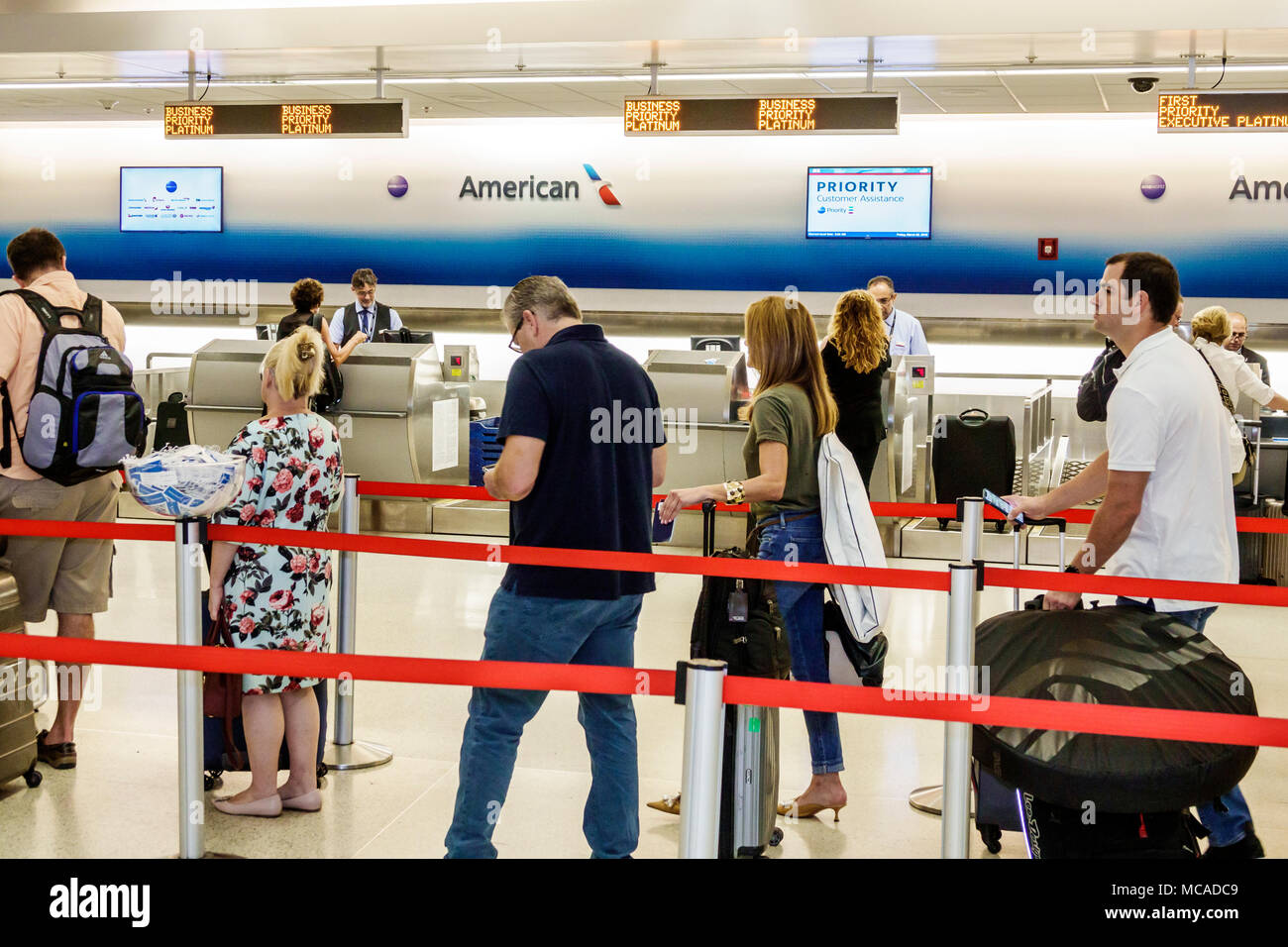 845d4c0c927 Florida Miami Miami International Airport MIA terminal American Airlines  ticket counter priority customers line queue man