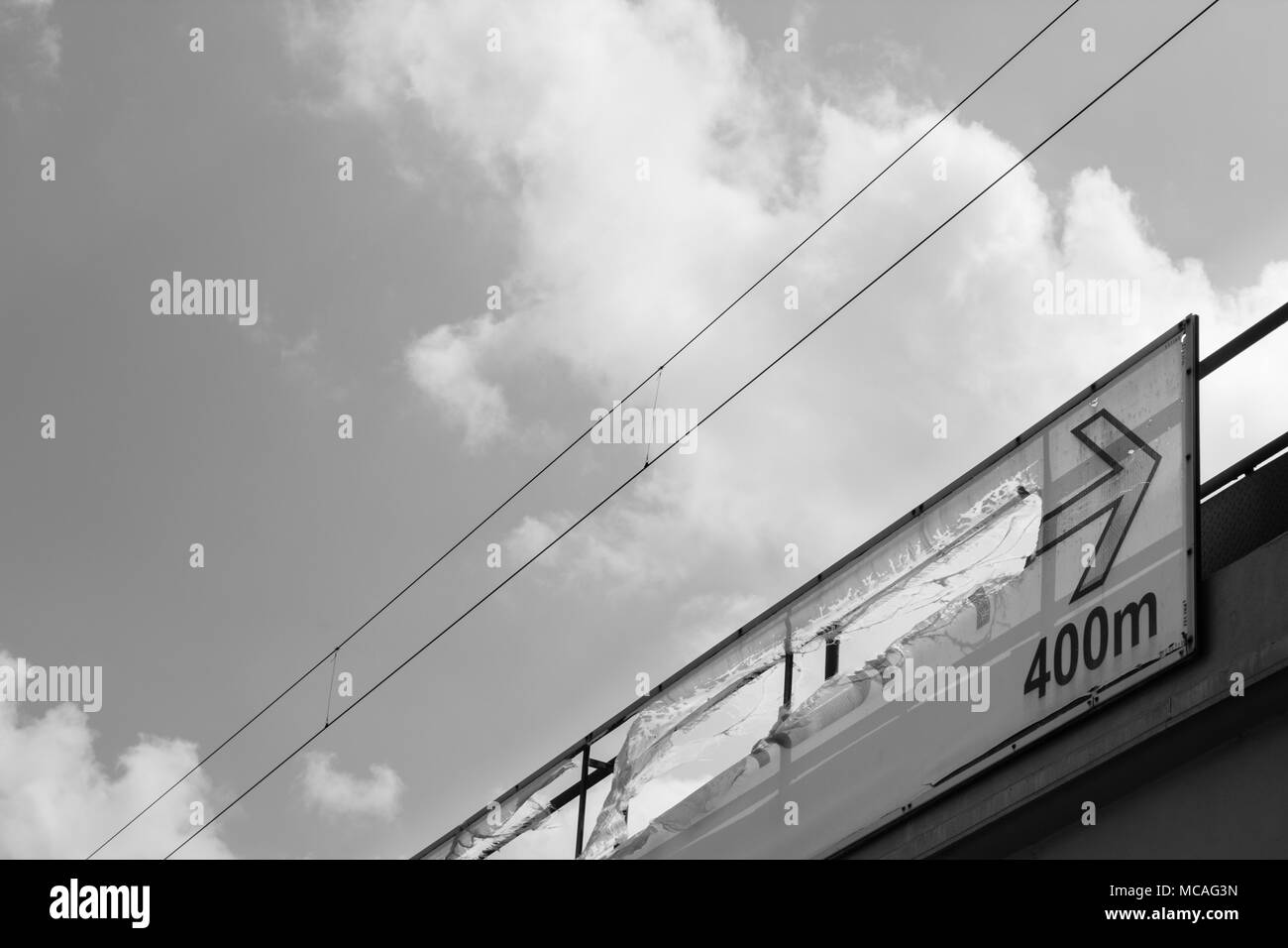 Photo of a broken sign in black and white. Stock Photo