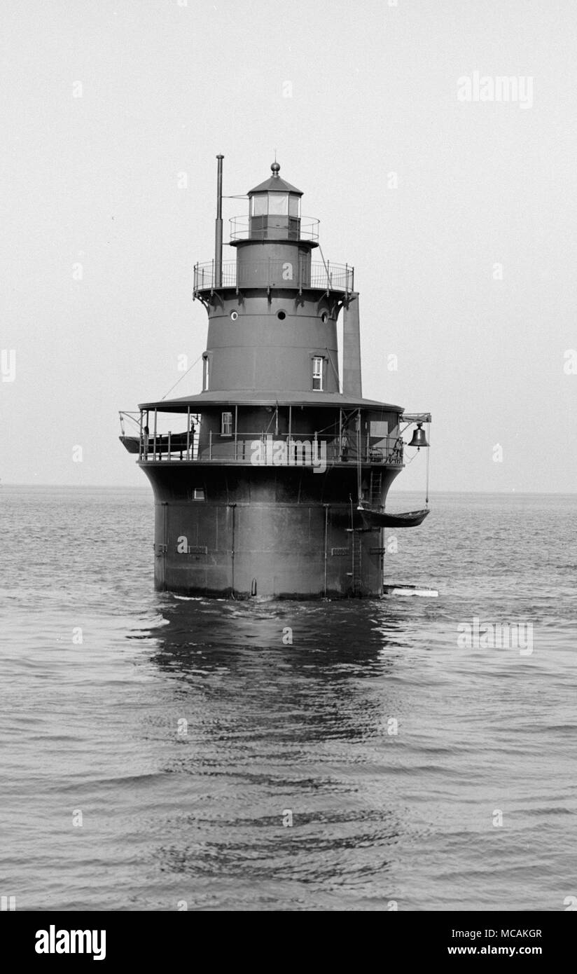 The light is at the end of a reef that extends about 1,500 feet  south from the island. The location first had a stone beacon in 1832. The first light, a sparkplug type light, was lit in 1890. It cost about $50,000. It included a three story dwelling, a veranda with boat davits, and a circular parapet. The water supply was a cistern in the base of the structure. A spiral staircase ran from the cellar to the top floor. It had a fixed white light, which was changed to flashing red every thirty seconds and then to the present alternating red and white flashes. - Stock Image