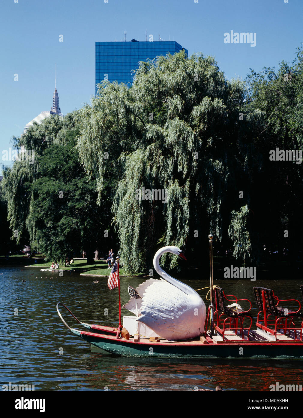 The Swan Boats are a fleet of dual-pontooned pleasure boats which operate in a pond in the Public Garden in Boston, Massachusetts. The Swan Boats have been in operation since 1877, and have since become a cultural icon for the city.  Robert Paget first created the Swan Boats in the Public Garden in 1877 after operating a Row Boat rental operation, after seeing the opera Lohengrin with his wife Julia Paget. Inspired by the Knight's gallant rescue of the damsel by riding a Swan across the lake, Paget decided to capitalize on the recent popularity of the bicycle and combine boat with swan and bic - Stock Image