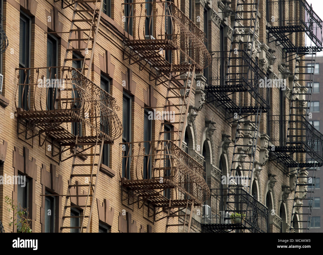 Fire escapes are most often found on multiple-story residential buildings, such as apartment buildings. At one time, they were a very important aspect of fire safety for all new construction in urban areas; more recently, however, they have fallen out of common use. - Stock Image