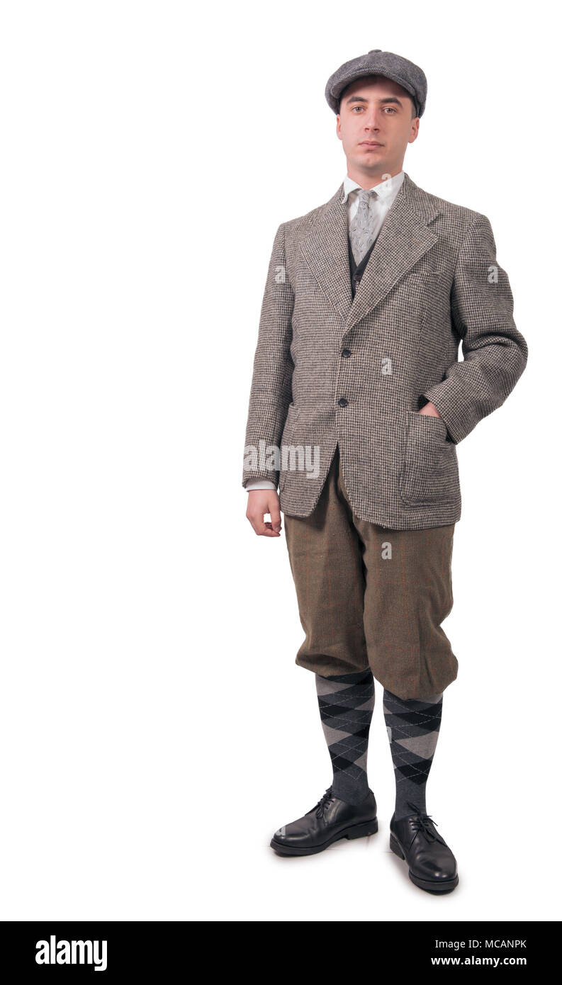 young man in vintage clothes with hat, 1940 style, isolated on the white background Stock Photo