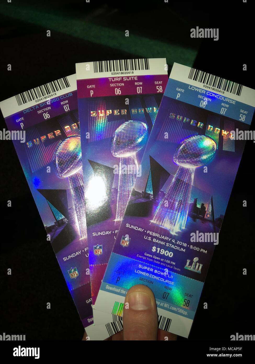 An example of legitimate tickets to Super Bowl 52. The National Intellectual Property Rights Center and the NFL have cautioned fans to avoid purchasing counterfeit tickets. - Stock Image