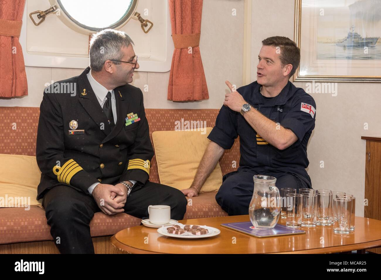 CONSTANTA, Romania, Feb 1. 2018 SNMCMG2 Commander, Justin Hains speaks with leadership from the Romanian Navy Hydrographic and Mine Warfare officers for an official visit aboard HMS Enterprise while the group is import Constanta, Romania February 1-4. Stock Photo