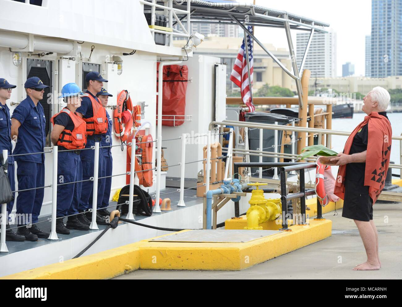 Leighton Tseu, Kane O Ke Kai, gives a Hawaiian blessing during the arrival of the Coast Coast Guard Cutter Joseph Gerczak (WPC 1126), at Coast Guard Base Honolulu, Feb. 4, 2018. The Joseph Gerczak is the second of three Honolulu-based FRCs that will primarily serve the main Hawaiian Islands.  (U.S. Coast Guard photo by Petty Officer 2nd Class Tara Molle/Released) Stock Photo