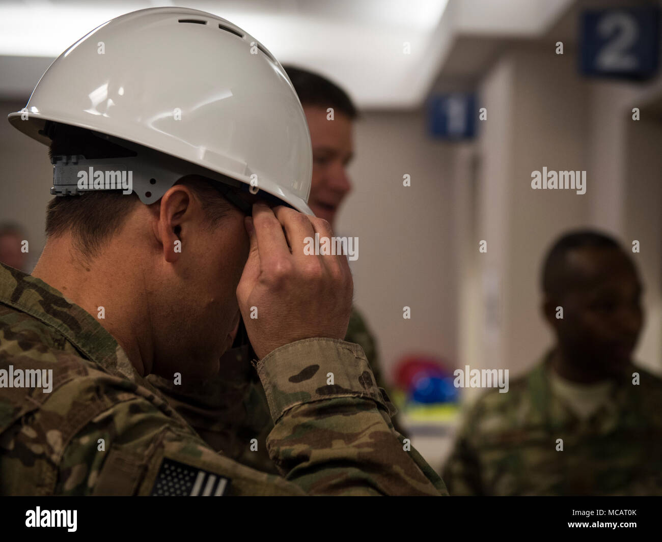 Air Commandos attend the 1st Special Operations Medical Group wall breaking ceremony at Hurlburt Field, Fla., Feb. 2, 2017. The wall breaking commenced the start of renovations in the pharmacy. (U.S. Air Force photo by Senior Airman Joseph Pick) - Stock Image