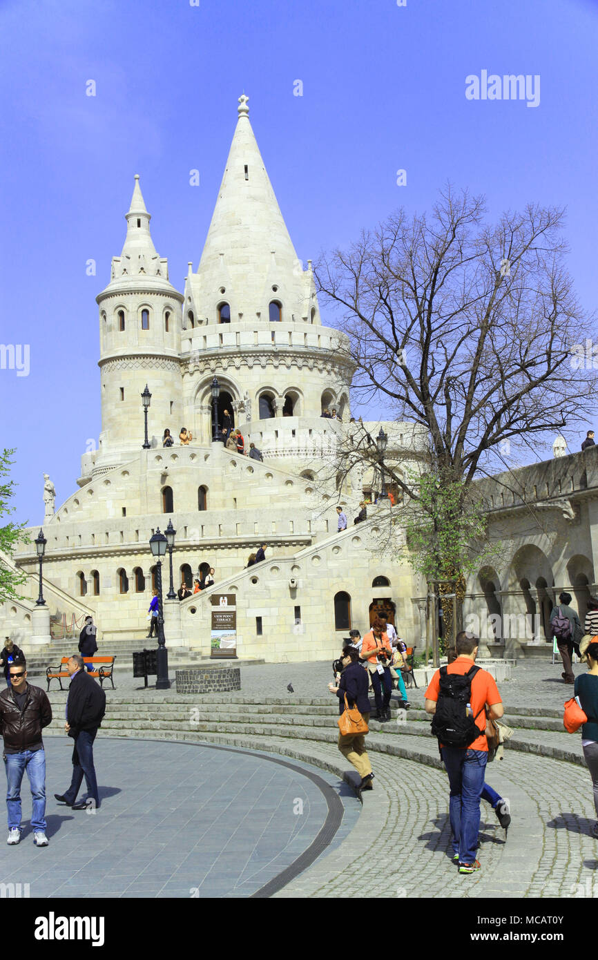 View of tourists and holiday makers around the Fisherman's bastion in  Hungarian capital city of Budapest Hungary  enjoying spring sunshine - Stock Image