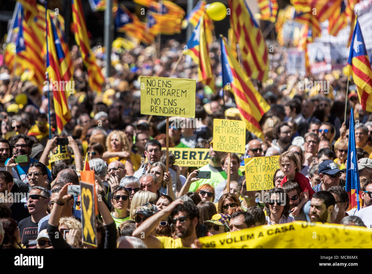 """Barcelona, Spain 15th April 2018  Protesters seen holding banner and waving the Catalan flag during the demonstration. A demonstration organized by social, cultural organizations, unions and political parties, under the motto """"We want you at home"""". Credit: SOPA Images Limited/Alamy Live News Stock Photo"""
