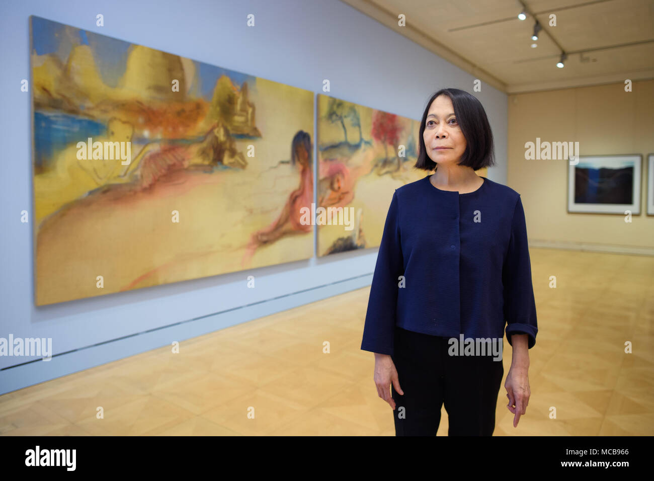10 April 2018, Germany, Berlin: Artist Leiko Ikemura stands next to one of her artistic works titled 'Sinus Spring' at the exhibition 'Leiko Ikemura im Dialog mit Donata und Wim Wenders' (lit. Leiko Ikemura in dialogue with Donata and Wim Wenders) at the Max-Liebermann Haus exhibition venue. The exhibition runs from 11 April to 27 May 2018. Photo: Gregor Fischer/dpa - Stock Image