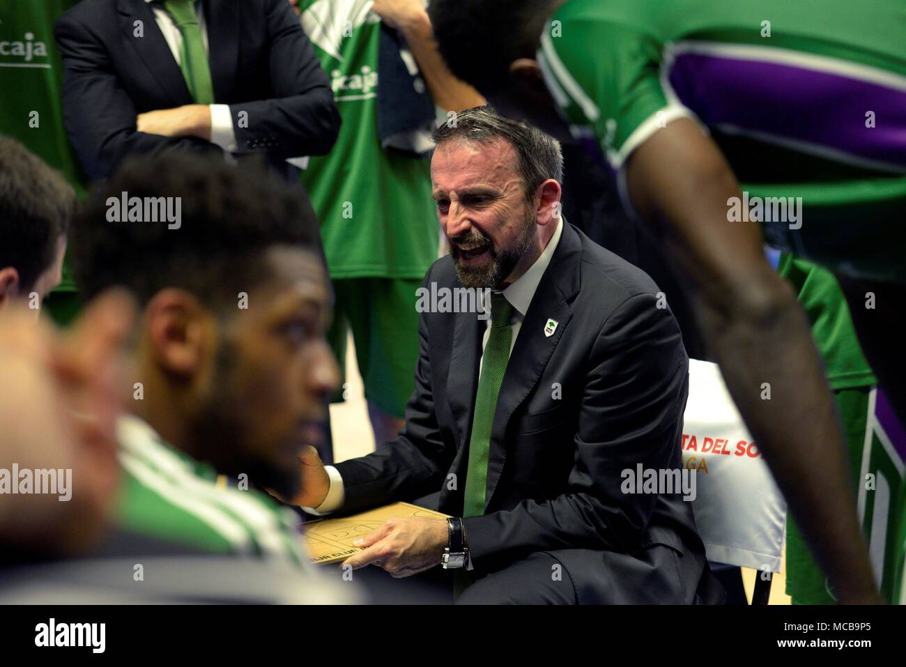 Malaga, Spain. 15th Apr, 2018. Unicaja's head coach Joan Plaza speaks with the players during a match between Unicaja Málaga and FC Barcelona Lassa of the Endesa League, at the Palacio de los Deportes José María Martín Carpena, in Malaga, Spain, on 15 April 2018. EFE/Juan Miguel Pérez Ramos Credit: EFE News Agency/Alamy Live News Stock Photo