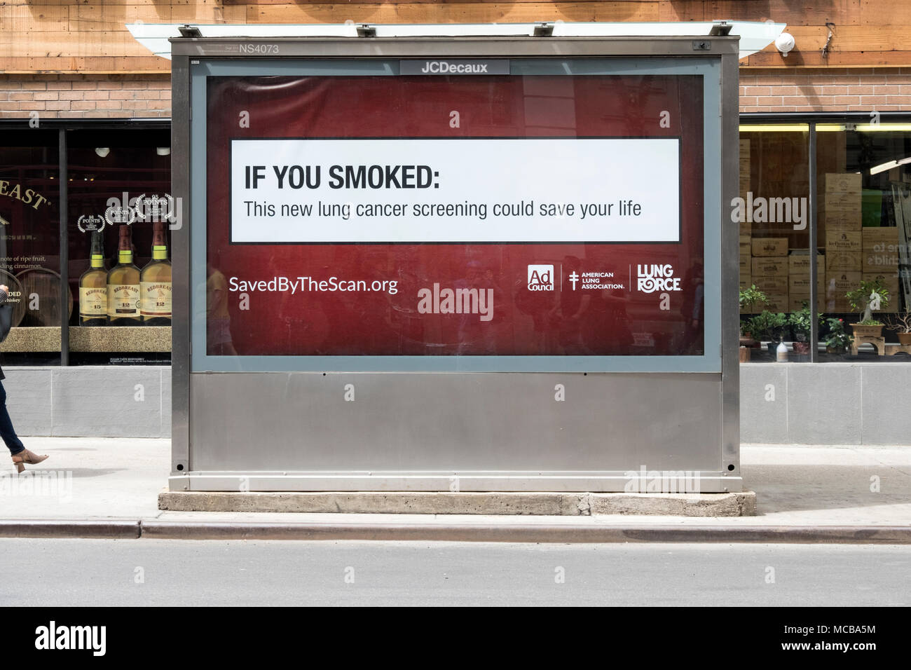 A public health warning sign to smokers & former smokers on the back of a newspaper kiosk on Broadway in Greenwich Village, Manhattan, New York City. Stock Photo