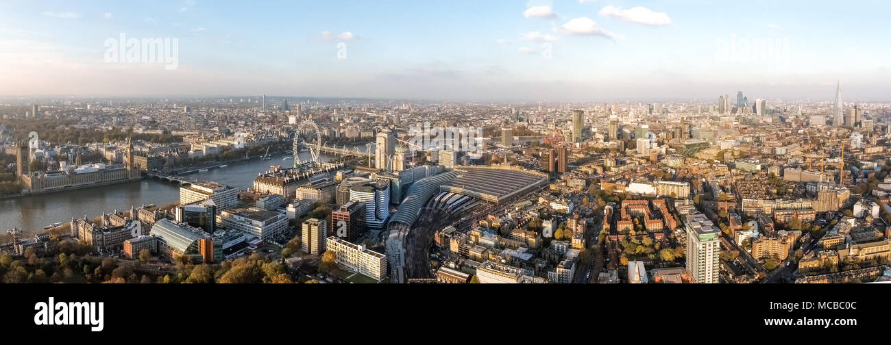 London Aerial Panorama View feat. Houses of Parliament, London Eye, Westminster on Thames River, Shard and Famous English Landmarks Skyline Wide Angle - Stock Image