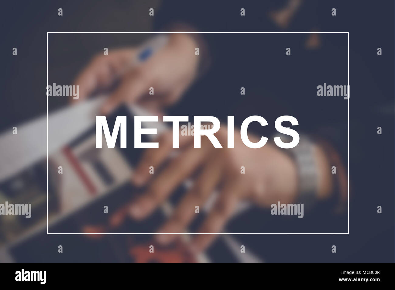 Metrics word with business blurring background - Stock Image