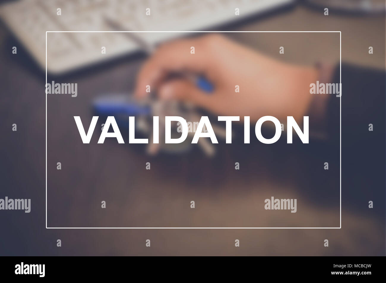 Validation word with business blurring background - Stock Image