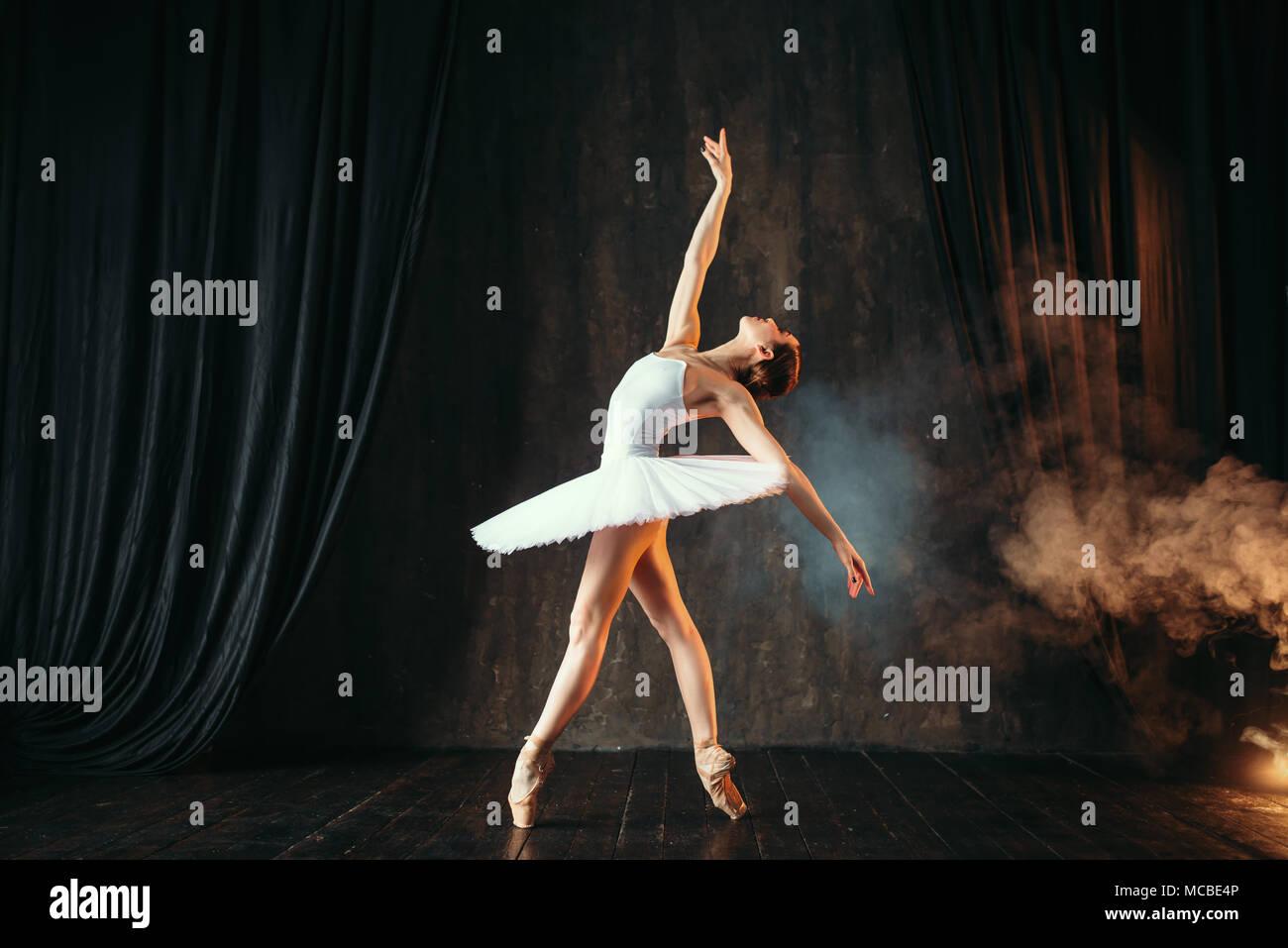 Ballerina in white dress dancing in ballet class - Stock Image