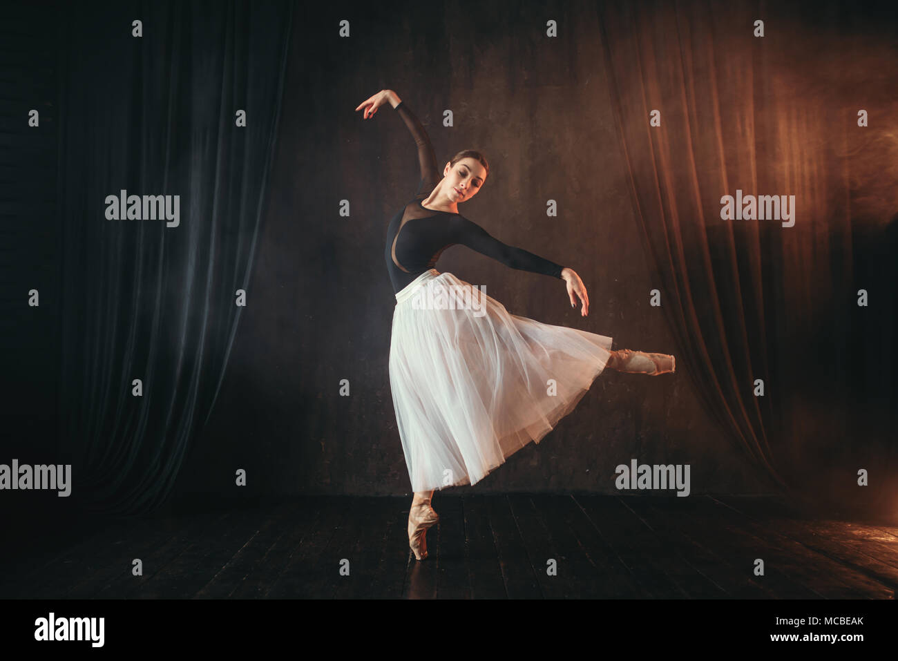 Classical ballet dancer in motion on the stage - Stock Image