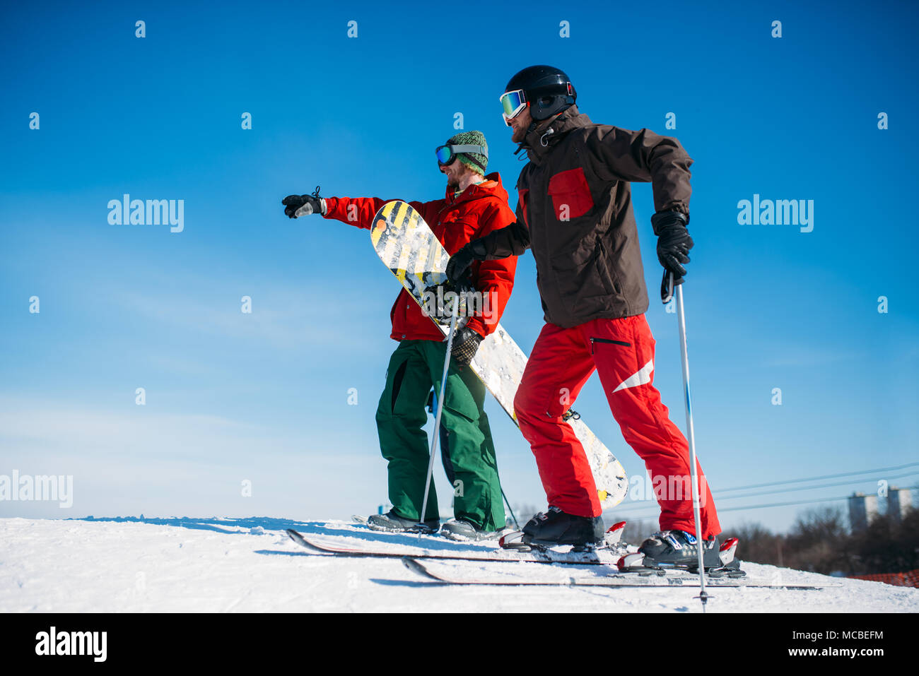 Downhill skiing, skiers on the top of slope - Stock Image