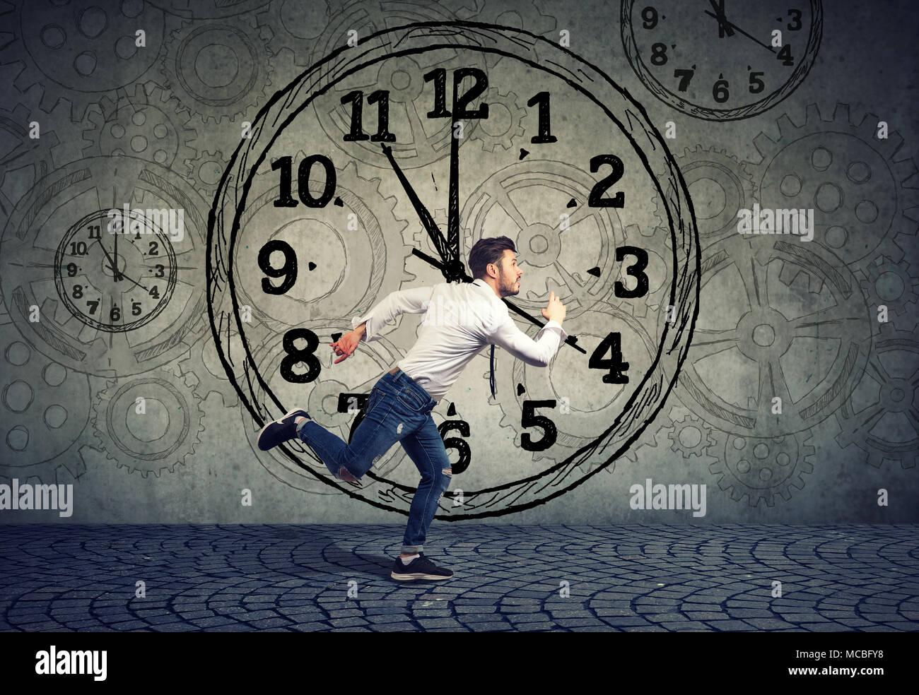Young business man running out of time - Stock Image