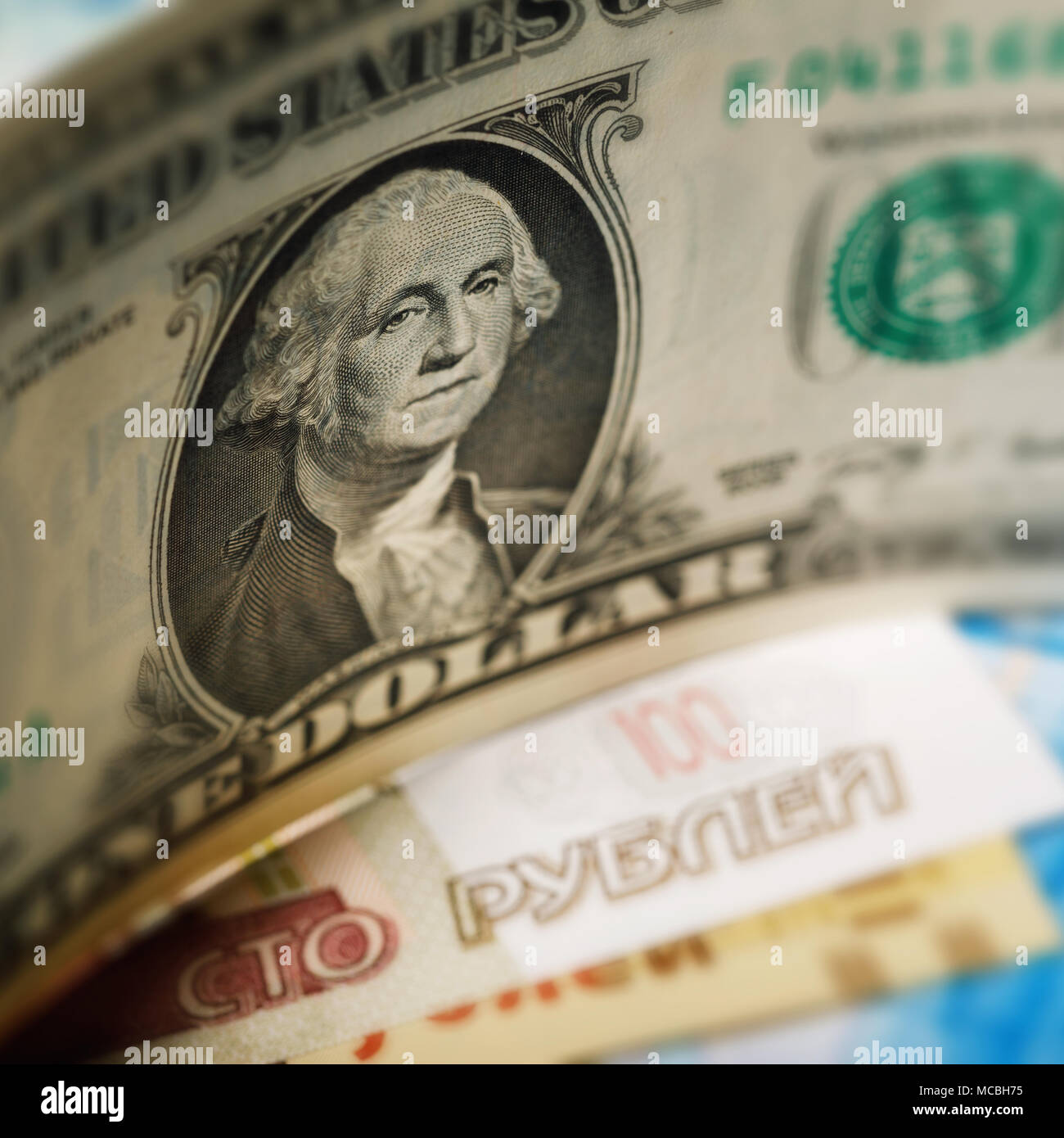 American dollar and Russian banknotes close-up. Economic crisis in Russia - Stock Image