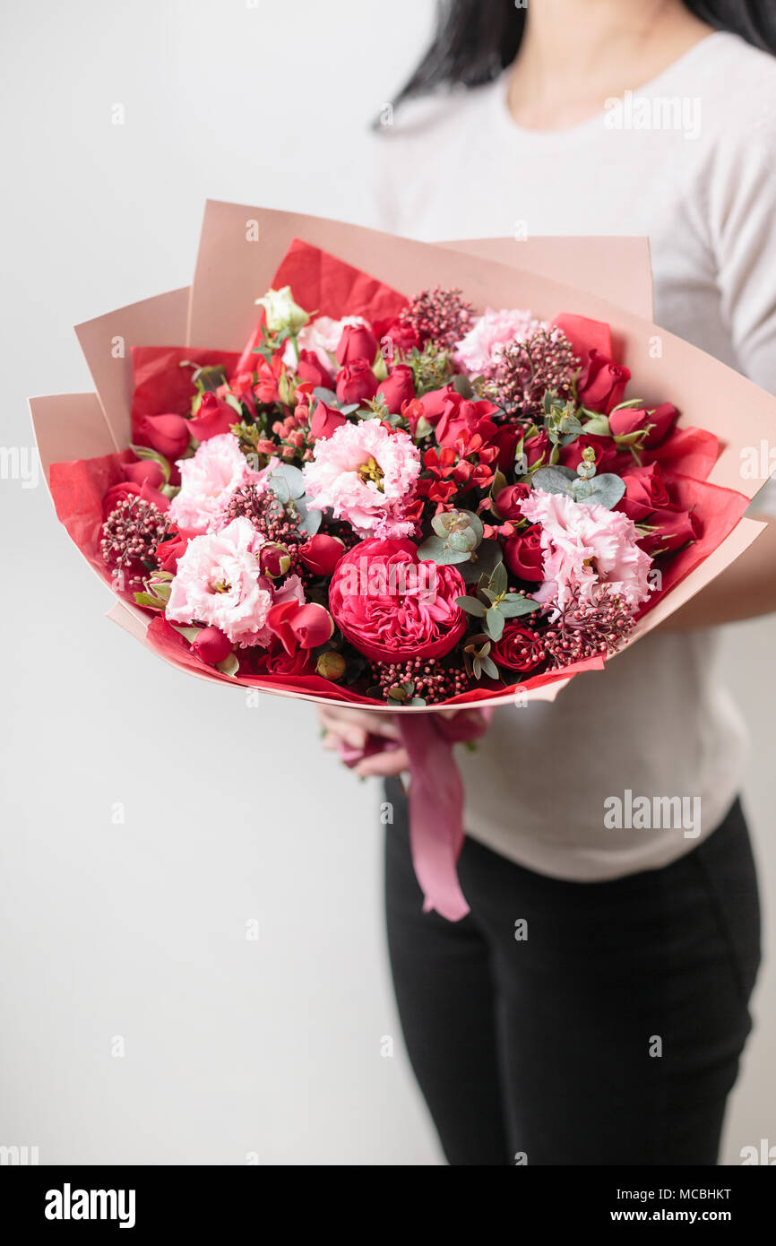 bouquet of beautiful flowers in women\'s hands. Floristry concept ...