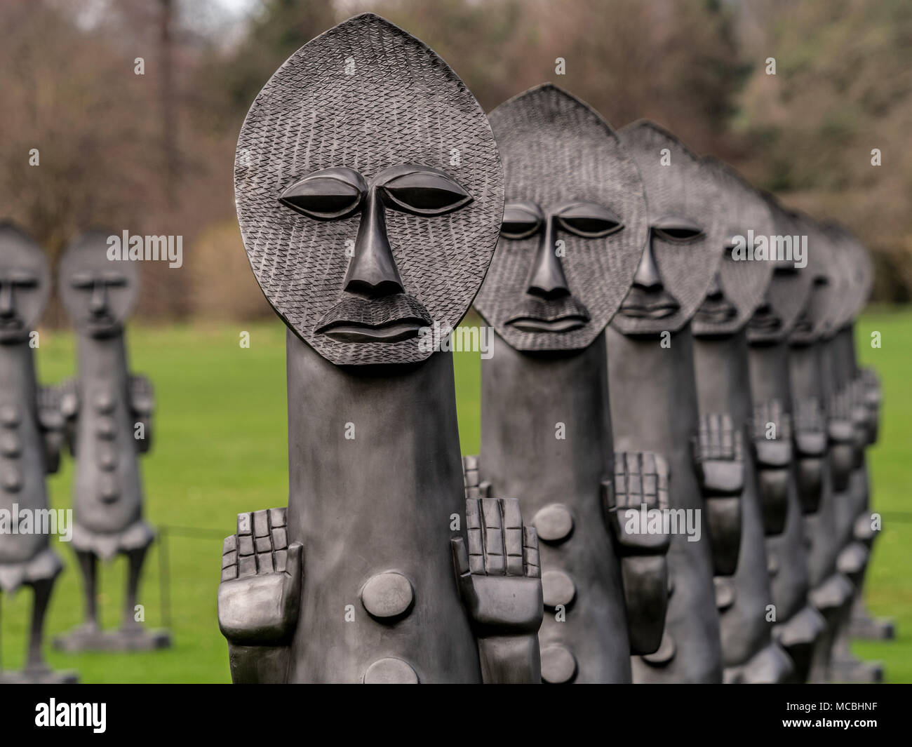 'Black and Blue: The invisible man and the mask of blackness 2016-2017' fibreglass and graphite sculptures by Zak Ove at Yorkshire Sculpture Park, UK. - Stock Image