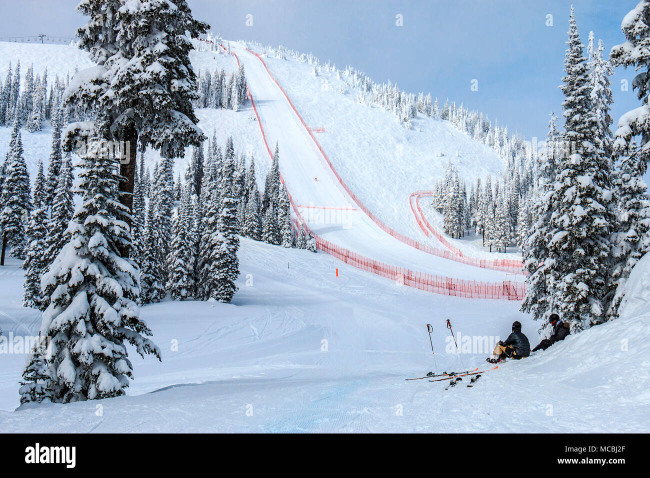 FIS Speed World Cup downhill ski race at Sun Peaks Resort in British Columbia, Canada. Racers come straight down a steep run without turning to see who is fastest. - Stock Image