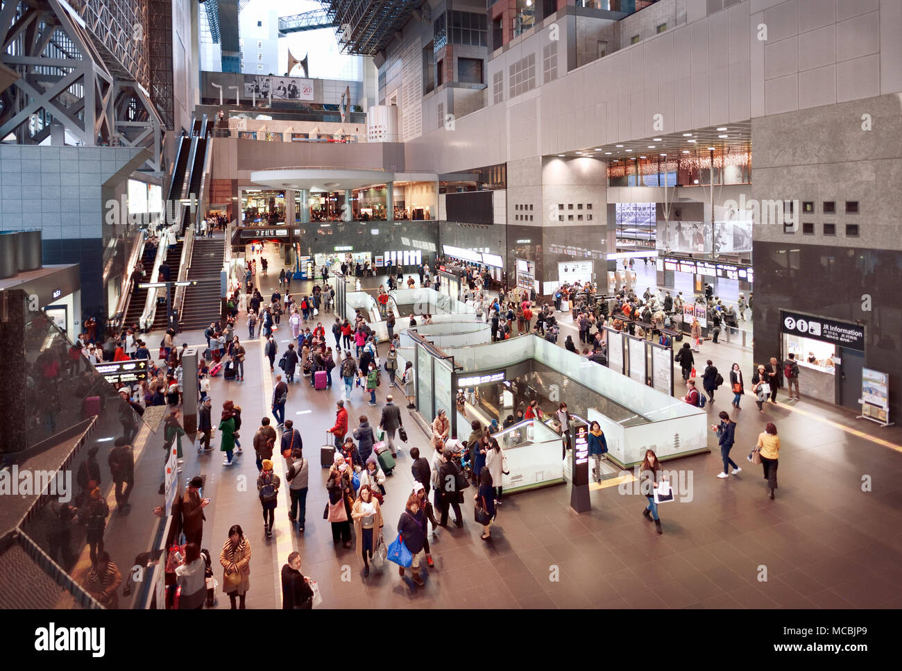 Kyoto Station building interior busy with people in the evening, Shimogyo-ku, Kyoto, Japan - Stock Image