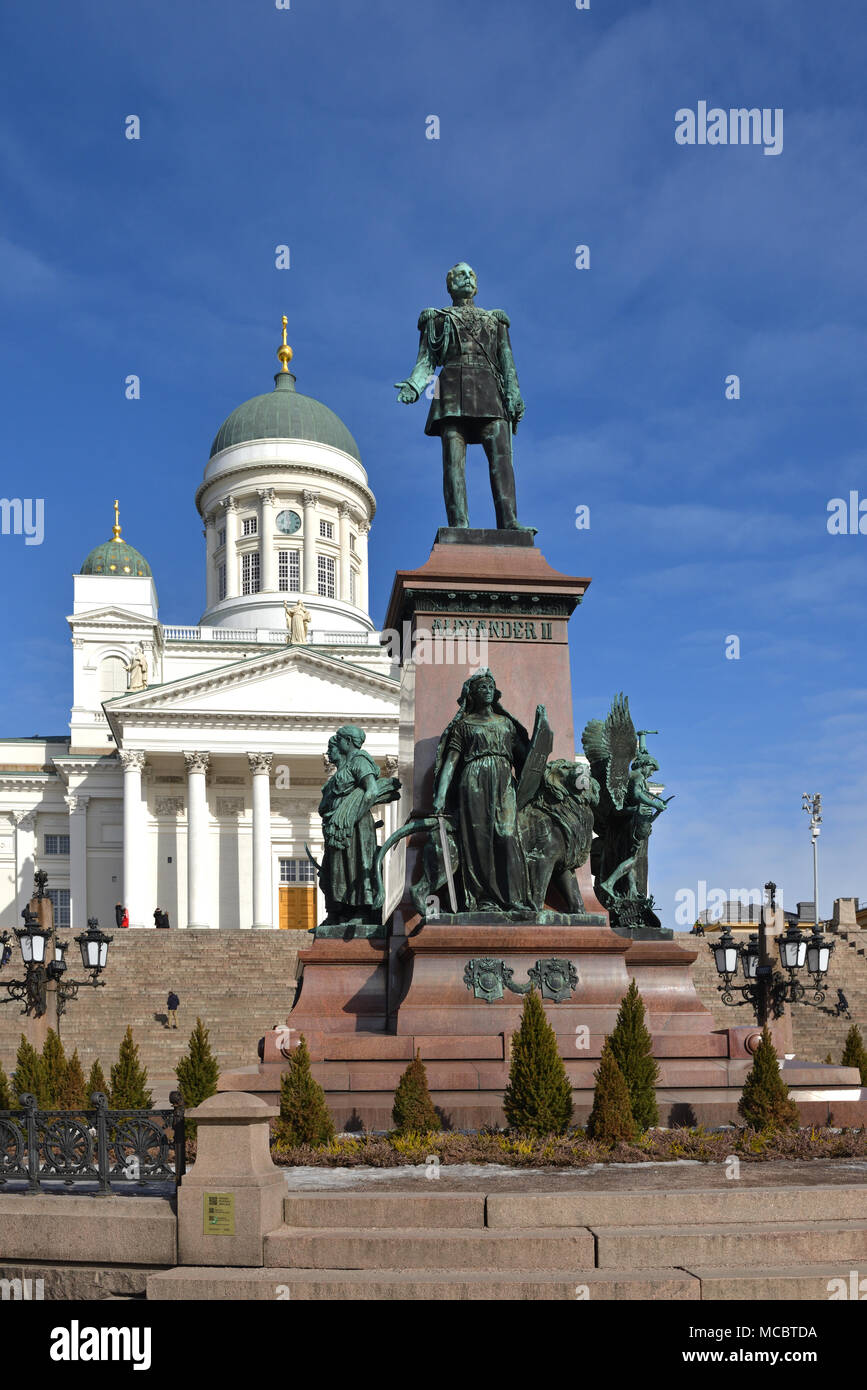 Statue of Emperor Alexander II of Russia and Finnish Evangelical Lutheran cathedral of Diocese of Helsinki - Stock Image