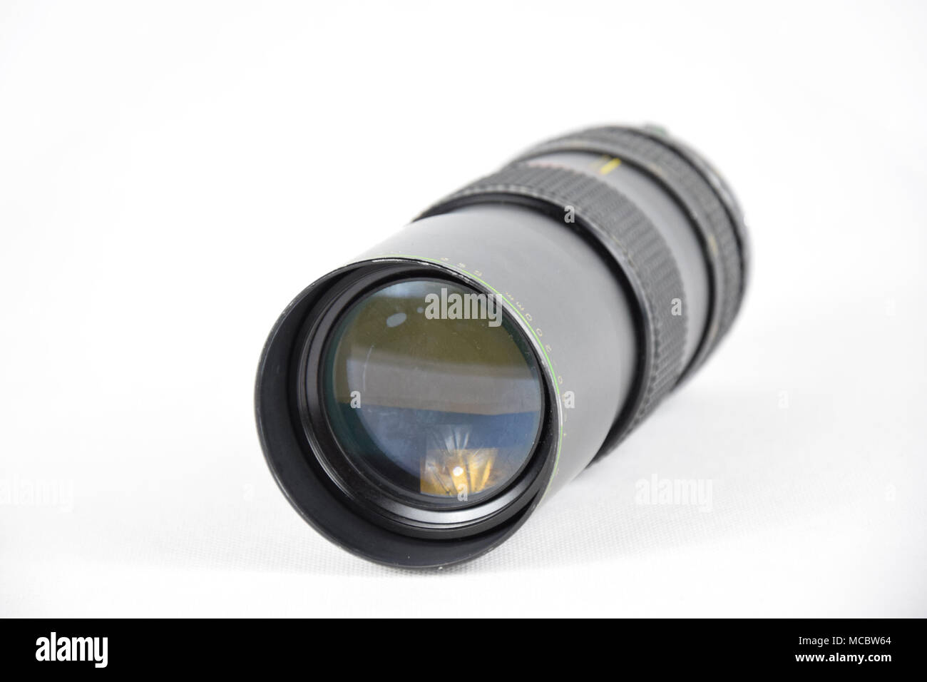 Old 80 - 200 mm Camera Lens - Isolated - Looking into the Glass Eye - Stock Image