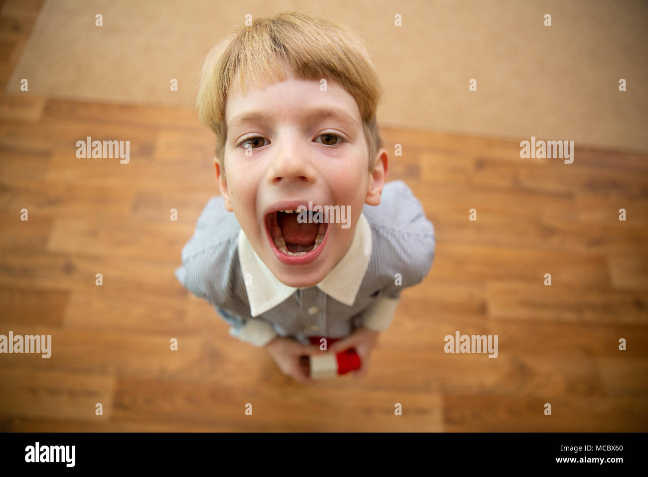 Little boy screaming. boy with open mouth. view from above Stock Photo