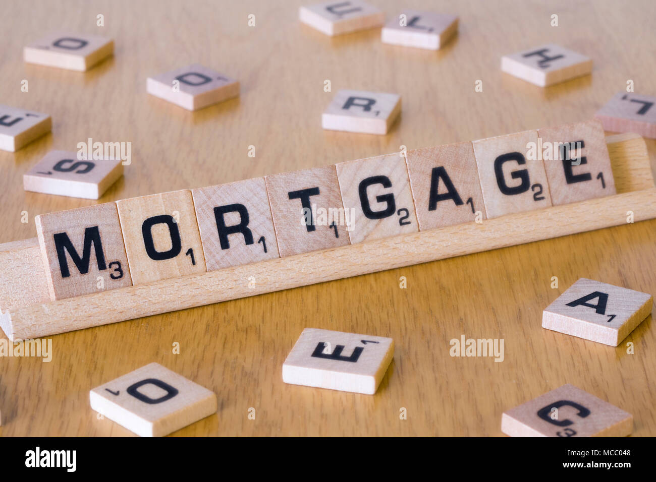Scrabble letters spelling out the word Mortgage - Stock Image