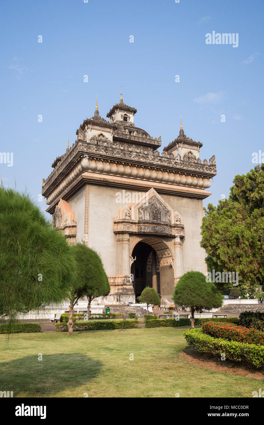 View of the Patuxai (Victory Gate or Gate of Triumph) war monument in Vientiane, Laos, on a sunny day. - Stock Image