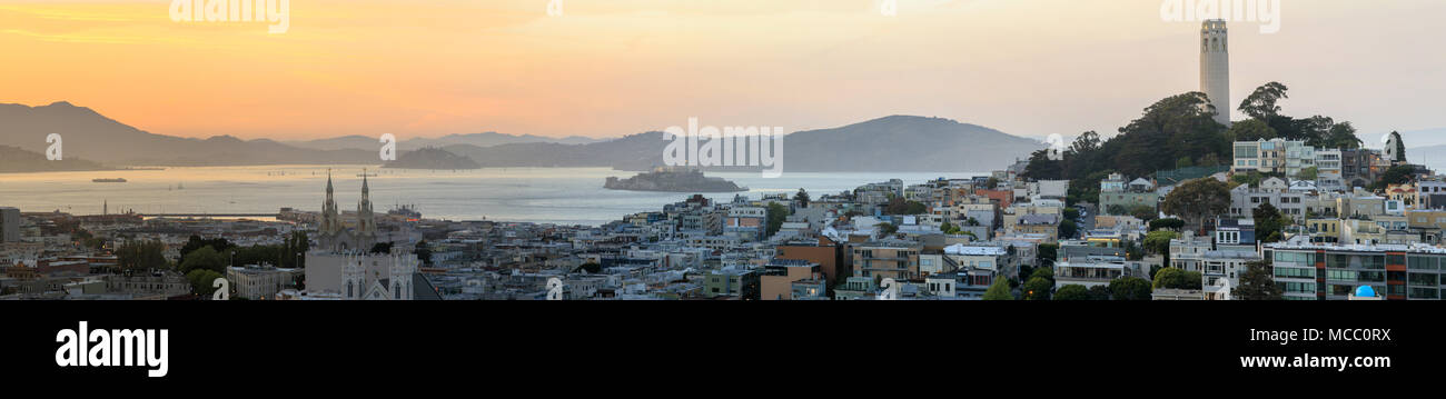 Sunset panoramic views of Telegraph Hill and North Beach neighborhoods with San Francisco Bay, Alcatraz and Angel Islands as well as Marin Headlands. - Stock Image