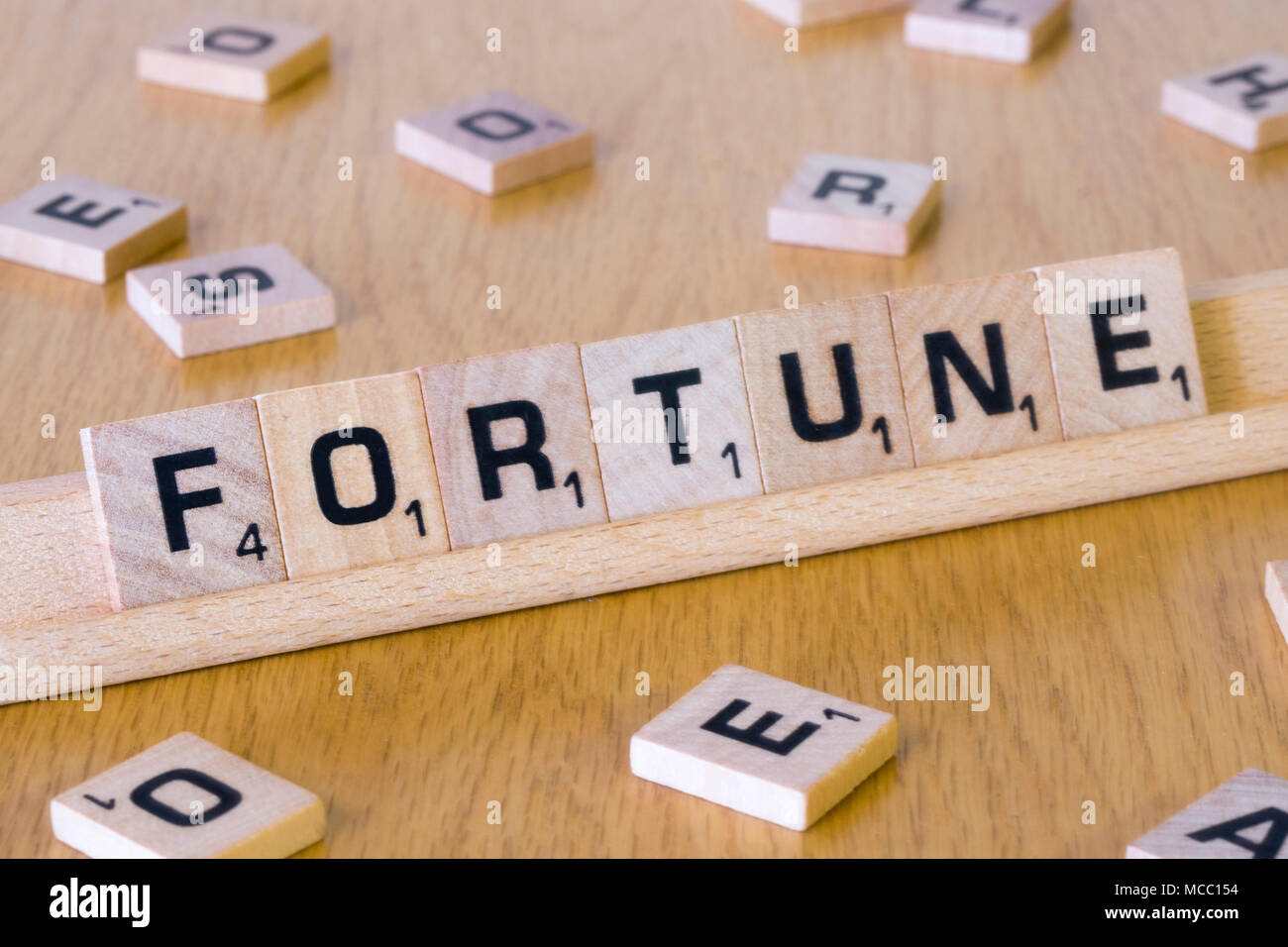 Scrabble letters spelling out the word Fortune - Stock Image