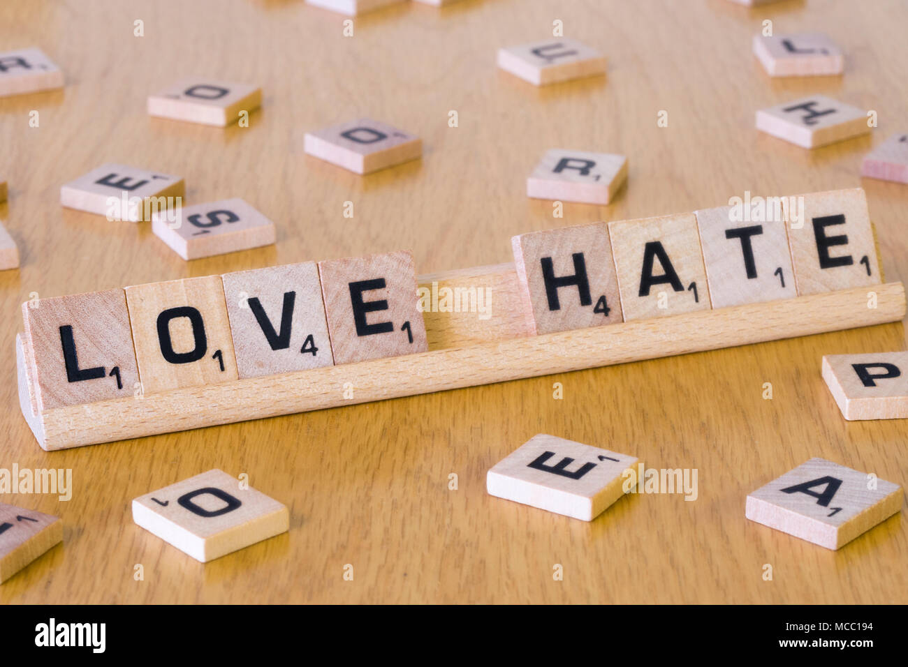 Scrabble letters spelling out the words Love & Hate - Stock Image