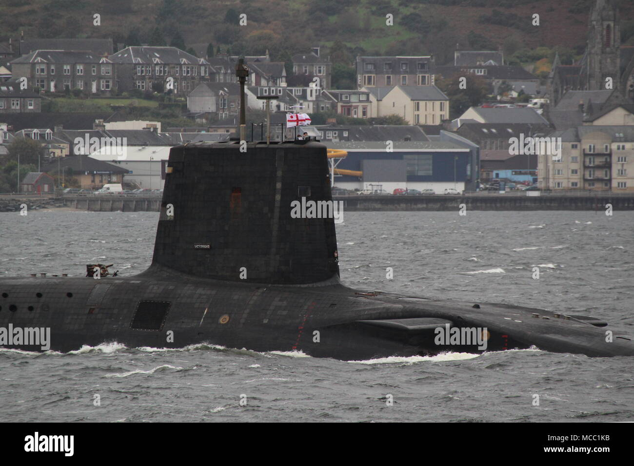 HMS Victorious (S29), a Vanguard-class submarine operated by the Royal Navy, passing Gourock on an inbound journey to the Faslane naval base. - Stock Image
