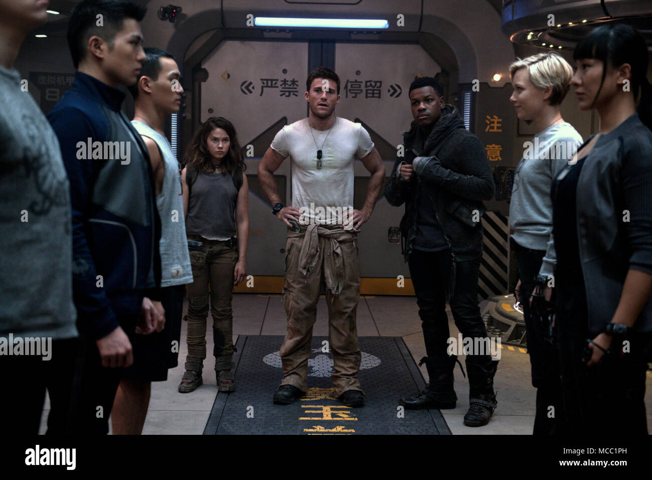 Pacific Rim Uprising is an upcoming American science fiction monster film directed by Steven S. DeKnight and written by DeKnight, Emily Carmichael, Kira Snyder, and T.S. Nowlin from a story by DeKnight and Nowlin. It is the sequel to the 2013 film Pacific Rim, and stars John Boyega, Scott Eastwood.  This photograph is for editorial use only and is the copyright of the film company and/or the photographer assigned by the film or production company and can only be reproduced by publications in conjunction with the promotion of the above Film. A Mandatory Credit to the film company is required. T Stock Photo