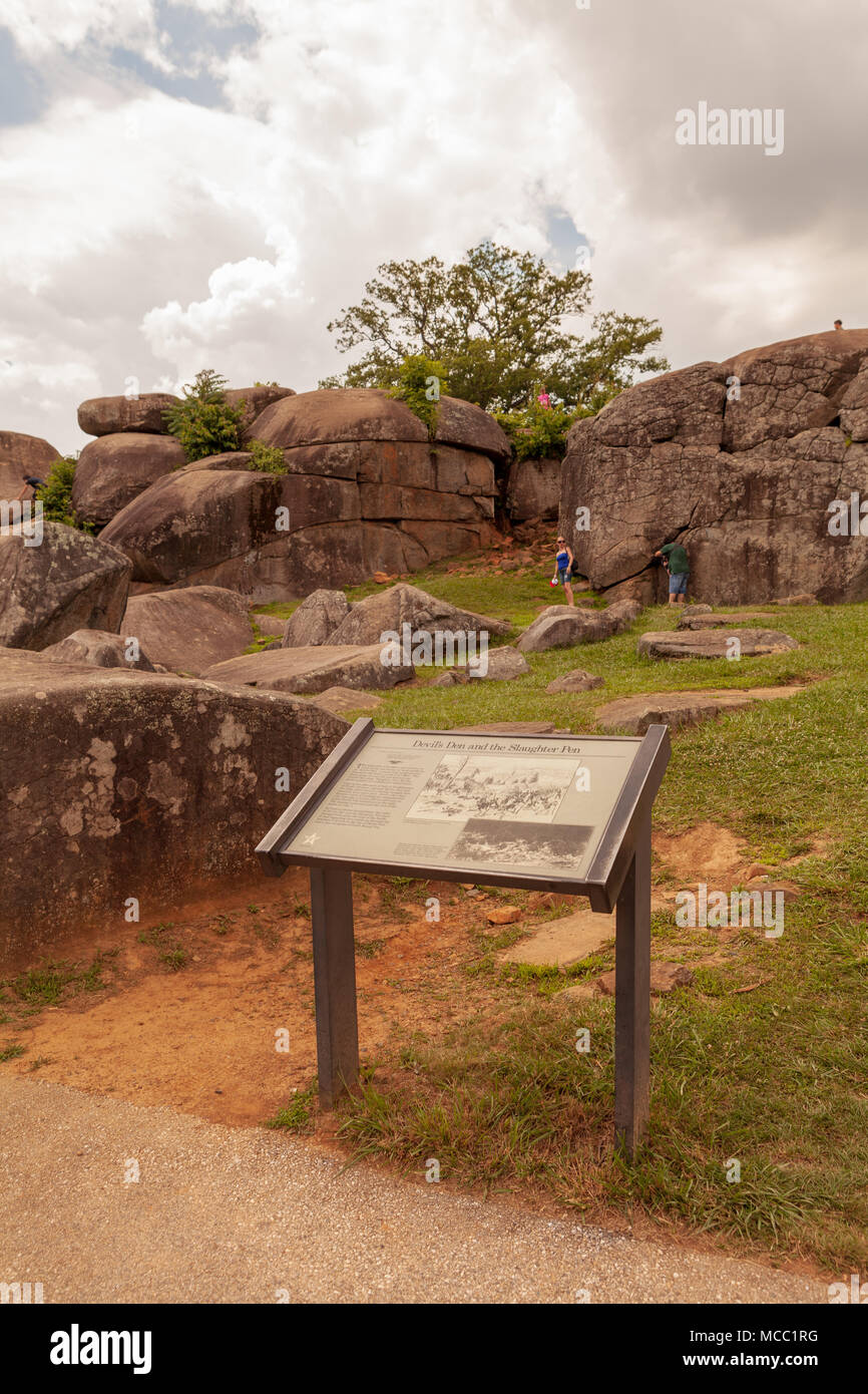 Gettysburg, PA, USA - July 8, 2013:  A visitors marker at Devil's Den on the Gettysburg Battlefield used artillery and infantry on day two of the 1863 Stock Photo