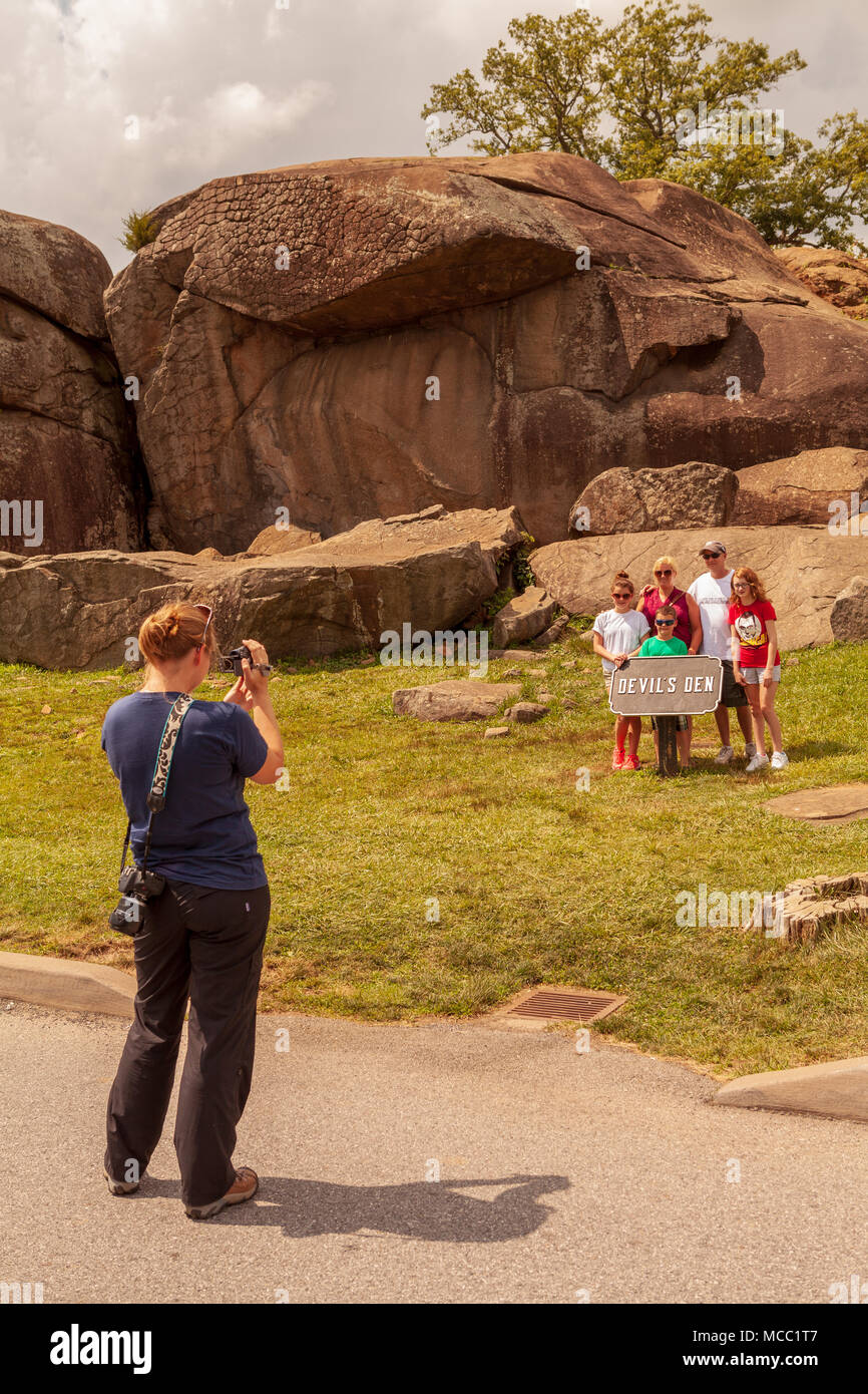 Gettysburg, PA, USA - July 8, 2013:  Visitors pose for a photo at Devil's Den on the Gettysburg battlefield. Stock Photo