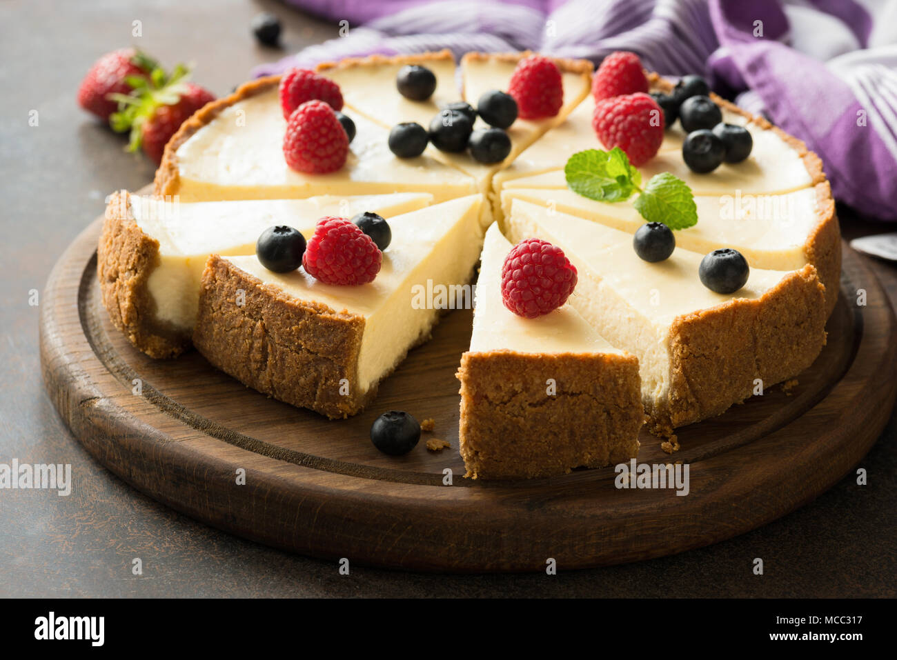 Summer berry cheesecake cut into slices. Selective focus Stock Photo