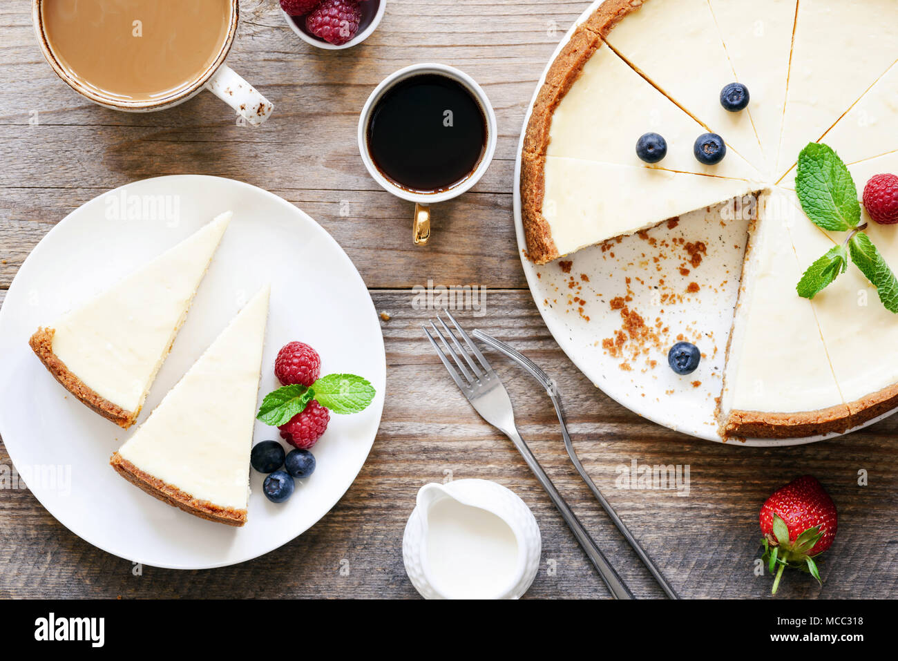 Homemade classical New York cheesecake and coffee on wooden table. Top view - Stock Image