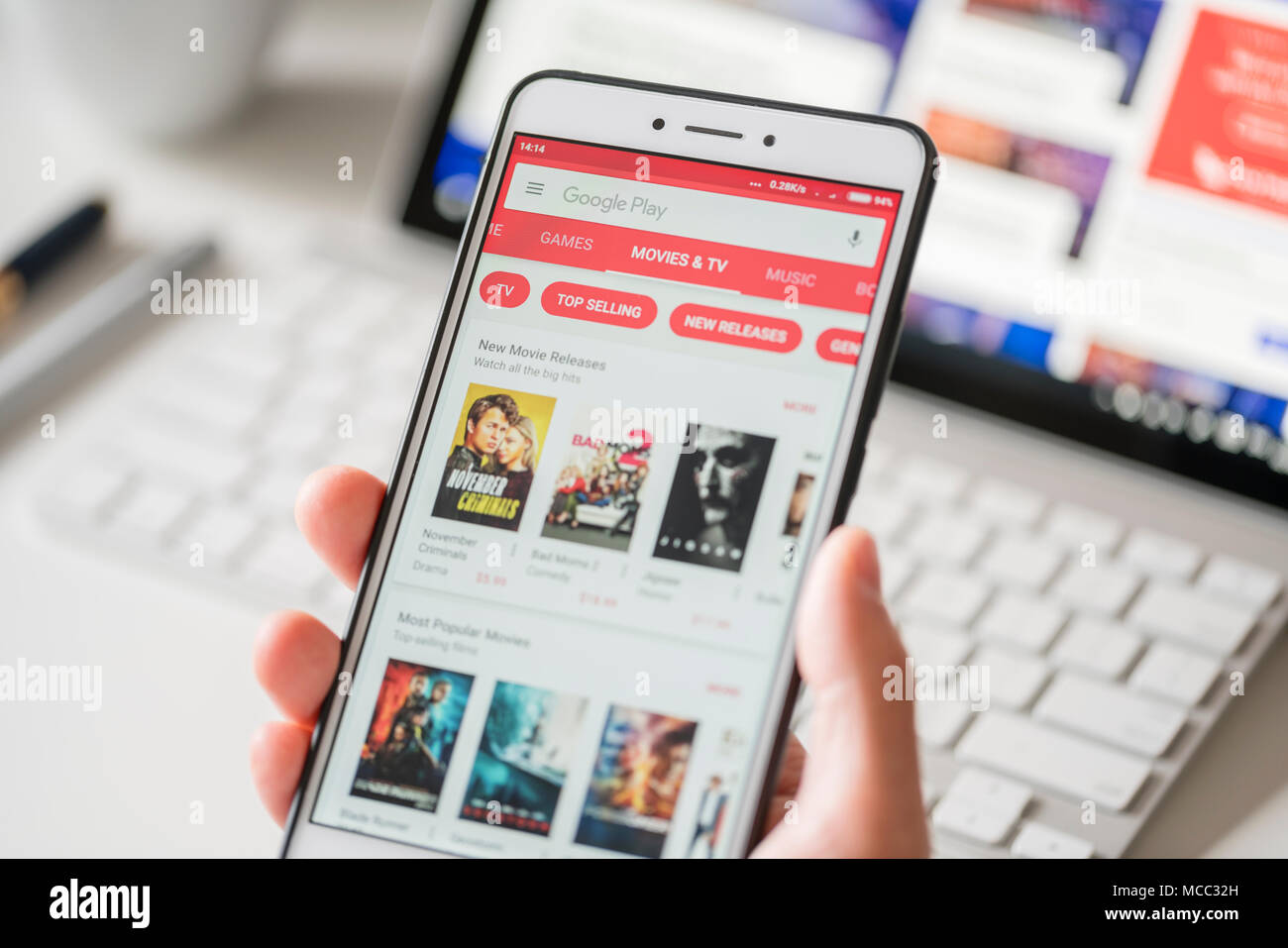 Melbourne, Australia - Feb 2, 2018: Browsing the movies and TV programmes in Google Play Store on a smartphone - Stock Image
