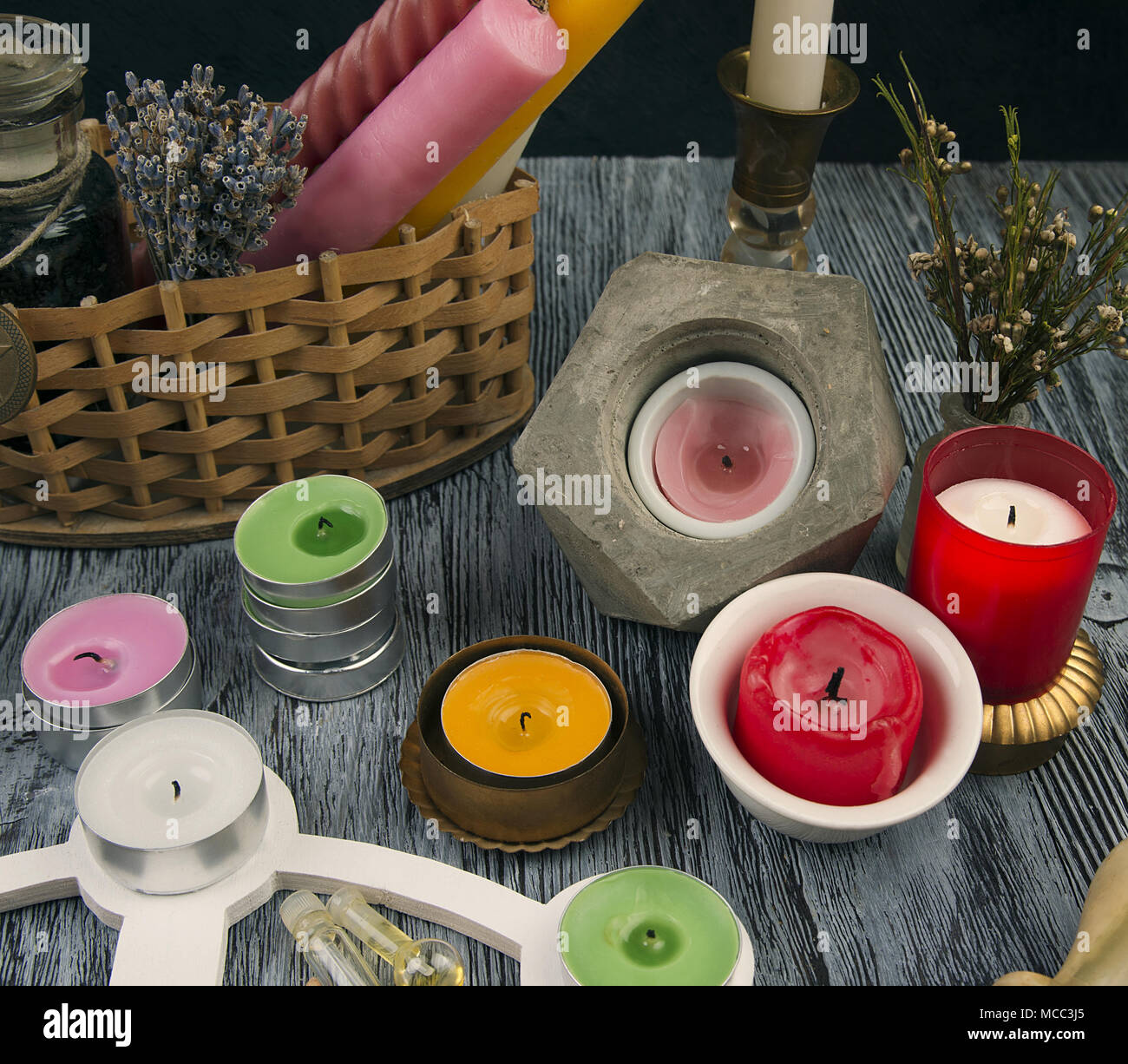 Altar with Wheel of year, pentagram and colorful candles - Stock Image