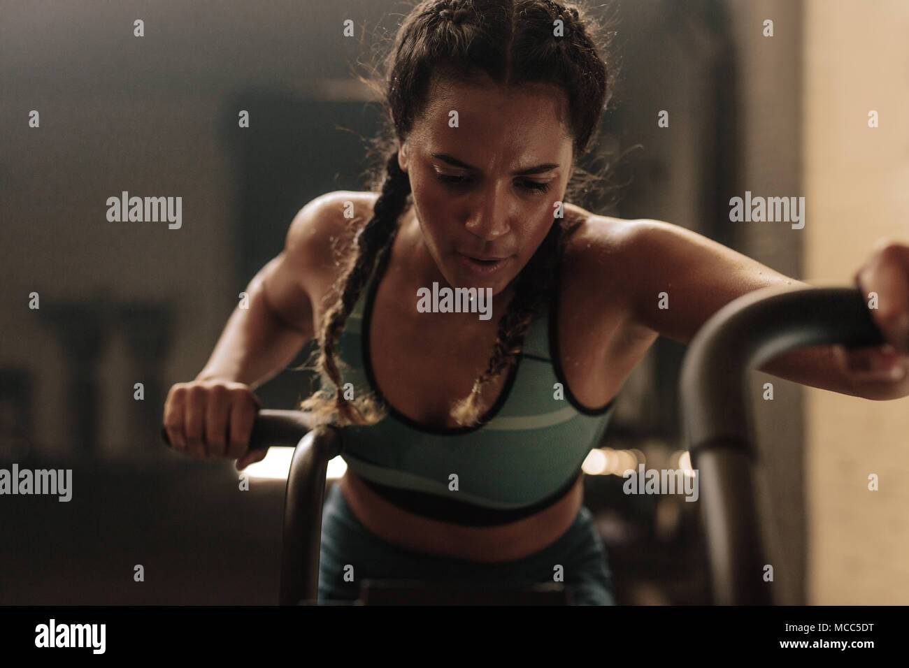 Woman Doing Intense Workout On Gym Bike Fitness Female Using Air